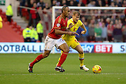 MK Dons defender Kyle McFadzean challenges for the ball during the Sky Bet Championship match between Nottingham Forest and Milton Keynes Dons at the City Ground, Nottingham, England on 19 December 2015. Photo by Aaron Lupton.