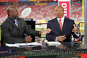 GLENDALE, AZ - JANUARY 8:  Emmitt Smith gestures and makes a point to Eddie George on the set of the FOX Sports television pregame show rehearsal at the Ohio State Buckeyes game against the Florida Gators at the 2007 Tostitos BCS National Championship Game at the University of Phoenix Stadium on January 8, 2007 in Glendale, Arizona. The Gators defeated the Buckeyes 41-14. ©Paul Anthony Spinelli *** Local Caption *** Emmitt Smith;Eddie George