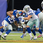 Oct 25, 2015; East Rutherford, NJ, USA; New York Giants running back Rashad Jennings (23) tackled by Dallas Cowboys outside linebacker Sean Lee (50) in the 1st quarter, at MetLife Stadium. Mandatory Credit: William Hauser-USA TODAY Sports