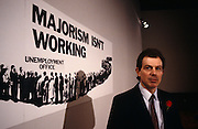 A young Rt. Hon. Tony Blair MP helps launch a 1992 General Election campaign referring to Prime Minister John Major' failing policies, at Millbank, the notorious Labour Party headquarters in central London. Then, Blair had the shadow employment brief, five years before he went on to beat John Major in the '97 election as Labour Party Leader and Prime Minister. We see him here as a still ambitious, young-looking front-bench Labour politician with a fresh face and very dark hair. He wears a Labour rose in his suit's lapel.
