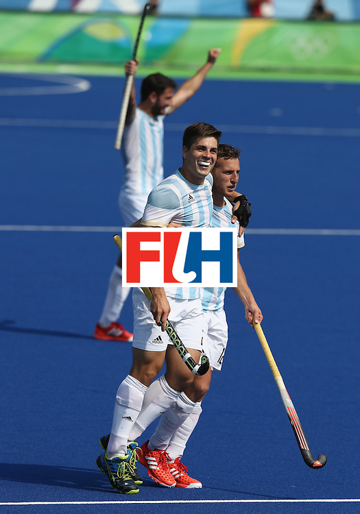 RIO DE JANEIRO, BRAZIL - AUGUST 16:  Gonzalo Peillat (L) of Argentina, who scored three goals in the match, celebrates with team mate Lucas Vila after their 5-2 victory during the Men's semi final hockey match between Argentina and Germany on Day 11 of the Rio 2016 Olympic Games held at the Olympic Hockey Centre on August 16, 2016 in Rio de Janeiro, Brazil.  (Photo by David Rogers/Getty Images)