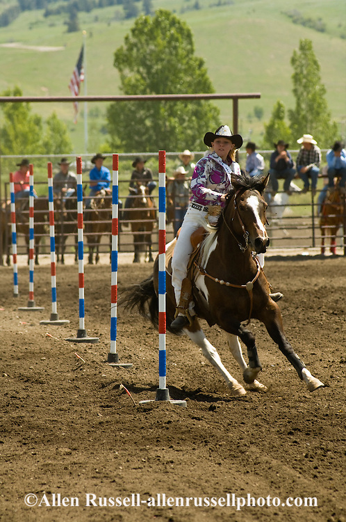 Montana High School Rodeo Finals, Carly Sykes, Rodeo Queen competes in Pole Bending, Paint Horse, Bozeman, Montana
