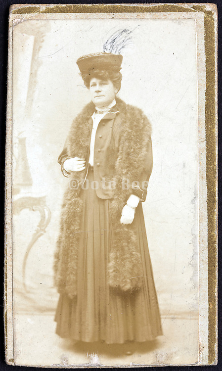 1900s portrait of woman where the hat has been scratched to look like a feather plume