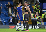 Chelsea Defender Cesar Azpilicueta consoles Sheffield Wednesday defender Sam Hutchinson (23) after the final whistle during the The FA Cup fourth round match between Chelsea and Sheffield Wednesday at Stamford Bridge, London, England on 27 January 2019.