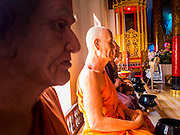 "03 APRIL 2015 - CHIANG MAI, CHIANG MAI, THAILAND: Lifelike statues of deceased revered monks in the ""wiharn"" (prayer hall) at Wat Phakhao, a temple in Chiang Mai, Thailand. The temple was built between 1487 and 1491 and was the home temple for  Thaomekuthisuthiwong, the 15th King of the Mangrai Dynasty, which ruled Chiang Mai before it became a part of Siam (Thailand).      PHOTO BY JACK KURTZ"