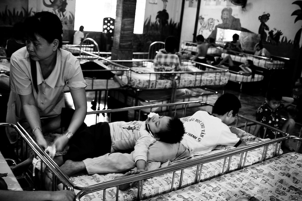 The Phu My Orphanage in Ho Chi Minh City, Vietnam is home to several hundred children with disabilities, many of which are terminal. It was founded and operated by the Catholic church, but currently funded by the Vietnamese goverment, along with private donations. Many visitors donate their time, efforts and love to help the severely outnumbered and overworked staff, which they are happy to do after spending even the shortest time with the young souls there.