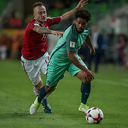 September 3, 2017 - Budapest, Hungary - Gergo Lovrencsics (L) of Hungary in action with Eliseu (R) of Portugal during the World Cup qualification match between Hungary and Portugal at Groupama Arena on Nov 03, 2017 in Budapest, Hungary. (Credit Image: © Robert Szaniszlo/NurPhoto via ZUMA Press)