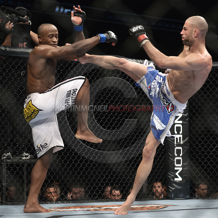 "LONDON, ENGLAND, OCTOBER 2010: Claude Patrick (left) tries to block a kick from James Wilks during ""UFC 120: Bisping vs. Akiyama"" inside the O2 Arena in Greenwich, London"