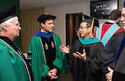 Graduate commemncement keynote speaker Jay Eungha Ryu (Right) talks with Ohio Trustees David Brightbiill (Left) and Peter Mather (Center) prior to commencement exercises on Friday, May 3, 2013. Photo by Ben Siegel