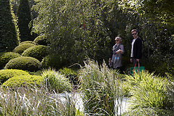 © licensed to London News Pictures. LONDON, UK  23/05/2011. Singer Will Young (R) in the Irish Sky Garden at 2011 RHS Chelsea Flower Show. The show held each year in the grounds of the Royal Chelsea Hospital and organised by the Royal Horticultural society opens to the general public tomorrow and is already sold out. Please see special instructions for usage rates. Photo credit should read CLIFF HIDE/LNP
