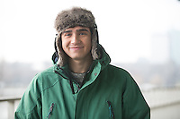 Portrait of man in winter wear smiling outdoors