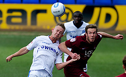 BIRKENHEAD, ENGLAND - Saturday, April 21, 2012: Tranmere Rovers' Adam McGurk in action against Hartlepool United's Andy Monkhouse during the Football League One match at Prenton Park. (Pic by David Rawcliffe/Propaganda)