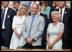 July 14, 2019 - London, London, United Kingdom - Image licensed to i-Images Picture Agency. 14/07/2019. London, United Kingdom. The Duke of Cambridge watching his wife the Duchess of Cambridge presenting the MenÃ•s Singles Trophy to Novak Djokovic on the last day of the Wimbledon Tennis Championships in London. (Credit Image: © Stephen Lock/i-Images via ZUMA Press)
