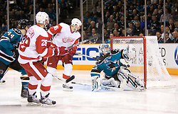 April 29, 2010; San Jose, CA, USA; Detroit Red Wings defenseman Brian Rafalski (second from left) follows his shot past San Jose Sharks goaltender Evgeni Nabokov (20) during the third period in game one of the western conference semifinals of the 2010 Stanley Cup Playoffs at HP Pavilion.  San Jose defeated Detroit 4-3. Mandatory Credit: Jason O. Watson / US PRESSWIRE