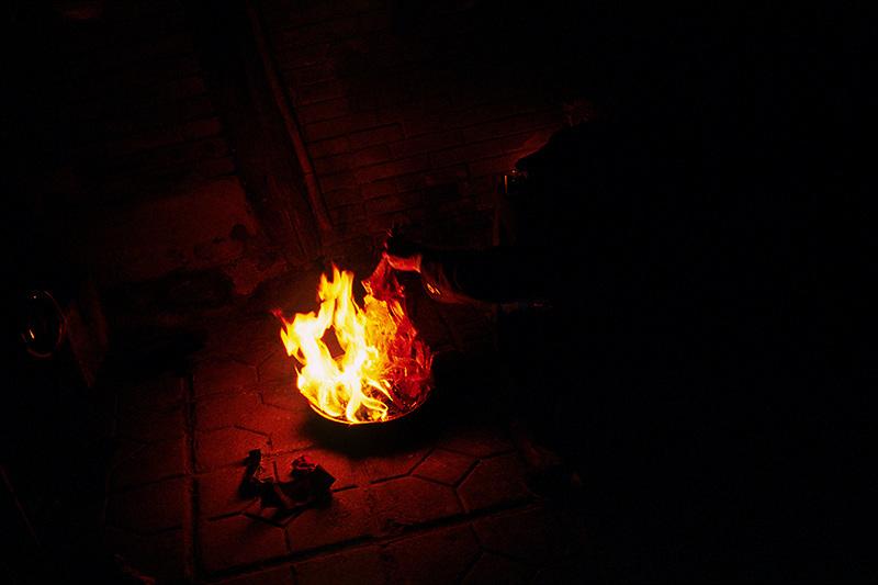 Burning money for ancestors. Chongqing, China. 2007