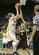 25 JANUARY 2007: Iowa center Megan Skouby (44) puts up a shot in front of Minnesota guard Emily Fox (4) in Iowa's 80-78 overtime loss to Minnesota at Carver-Hawkeye Arena in Iowa City, Iowa on January 25, 2007.