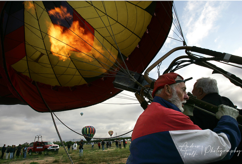 /Andrew Foulk/ For The Californian/.Wally Junkel, of San Fernando, helps get one of the 40 some hot air balloons in the air Saturday morning, during the 26th annual Temecula Balloon and Wine Festival.