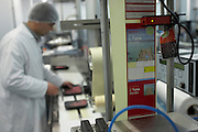 An employee of fish importers New England Seafoods, monitors the labelling of a supermarket order of fresh Maldives tuna
