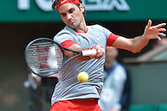 Roger Federer from Switzerland competes in men's single first round while Day First during The French Open 2014 at Roland Garros Tennis Club in Paris, France.<br /> <br /> France, Paris, May 25, 2014<br /> <br /> Picture also available in RAW (NEF) or TIFF format on special request.<br /> <br /> For editorial use only. Any commercial or promotional use requires permission.<br /> <br /> Mandatory credit:<br /> Photo by © Adam Nurkiewicz / Mediasport
