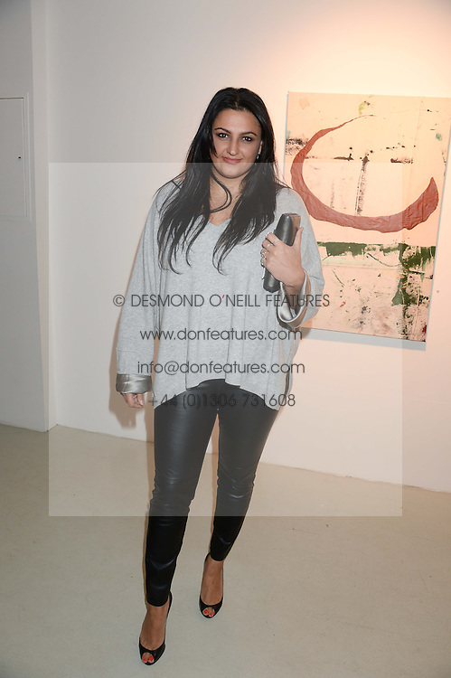 KIRAN SHARMA the manager of singer Prince at a private view of an exhibition of paintings by Billy Zane entitled 'Save The Day Bed' held at the Rook & Raven Gallery, Rathbone Place, London on 10th October 2013.