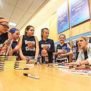The Kennett Crush Players Olivia O'Hara (11), Bridget Mcmanamon (11), Emily O'Hara (11), Quinn Simmons (10) and Ellie C, Soriano (10) chat with Elena Delle Donne while she signs their books Saturday, March 10, 2018, at Barnes and Noble in Wilmington Delaware.