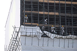 © Licensed to London News Pictures. 08/06/2018. London, UK. Construction workers complete covering Grenfell Tower ahead of the first anniversary of the Grenfell Tower fire which killed 72 people. Photo credit: Ray Tang/LNP