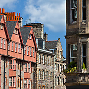 A salmon apartment building breaks the monotony of greys along the Royal Mile, Edinburgh, Scotland. Nice relief!