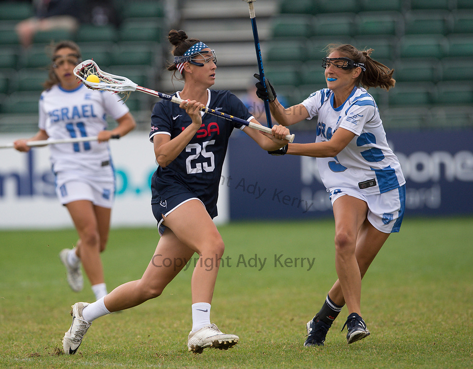 USA's Marie McCool  challenges with Israel's Alison Curwin at the 2017 FIL Rathbones Women's Lacrosse World Cup, at Surrey Sports Park, Guildford, Surrey, UK, 19th July 2017.