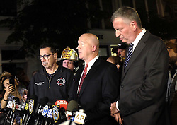 NEW YORK, Sept. 18, 2016 (Xinhua) -- New York Police Department Commissioner James O'Neill (C) and New York City Mayor Bill de Blasio (R) give a news conference near the blast site in New York, U.S., Sept. 17, 2016. New York City Mayor Bill De Blasio said Saturday that there is ''no evidence at this point of a terror connection'' to an explosion in New York Saturday evening.  (Xinhua/Li Muzi) (yy) (Credit Image: © Li Muzi/Xinhua via ZUMA Wire)