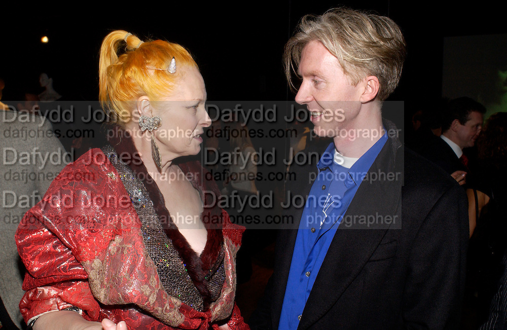 Vivienne Westwood and Philip Treacy, Opening of Vivienne Weatwood exhibition. V. & A. 30 March 2004. ONE TIME USE ONLY - DO NOT ARCHIVE  © Copyright Photograph by Dafydd Jones 66 Stockwell Park Rd. London SW9 0DA Tel 020 7733 0108 www.dafjones.com
