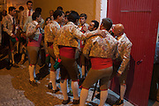 "A group of Portugese Forcados stand outside the bullring and show their camaraderie before the evening's bullfight (Corrida de Touros), on 15th July 2016, at Caldas da Rainha, Portugal. A forcado is a member of a group of men that performs the pega de cara or pega de caras (""face catch""), the final event in a typical Portuguese bullfight. They were initially professionals from lower classes but nowadays people from all social backgrounds practice their art through amateur groups. Unlike Spanish bullfights, in the Portuguese version, they do not kill the bull. (Photo by Richard Baker / In Pictures via Getty Images)"