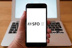 Using iPhone smartphone to display logo of Serious Fraud Office, SFO; UK Government,