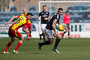 12th May 2018, Dens Park, Dundee, Scotland; Scottish Premier League football, Dundee versus Partick Thistle; Randy Wolters of Dundee goes past Paul McGinn of Partick Thistle