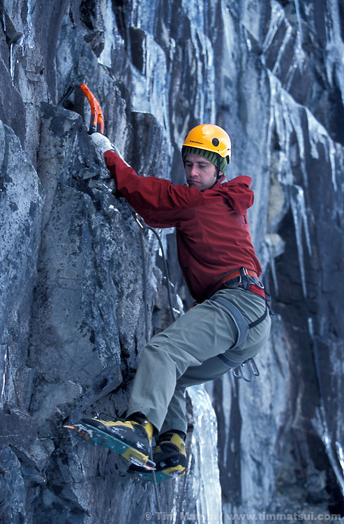 Roger Strong on an M7+ at the Rap Wall, a crag recently developed by Strong, in the Alpental Valley at Snoqualmie Pass, WA..