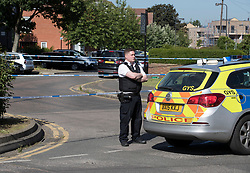 © Licensed to London News Pictures. 11/06/2018. London, UK. Police guard a cordon where a 17 year old was critically injured in a stabbing in Harrow last night.Police are also dealing with a stabbing incident in nearby Northolt where a 20 year old was injured. Photo credit: Peter Macdiarmid/LNP  Photo credit: Peter Macdiarmid/LNP