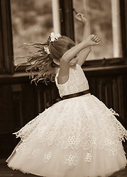 little girl in a formal dress dancing