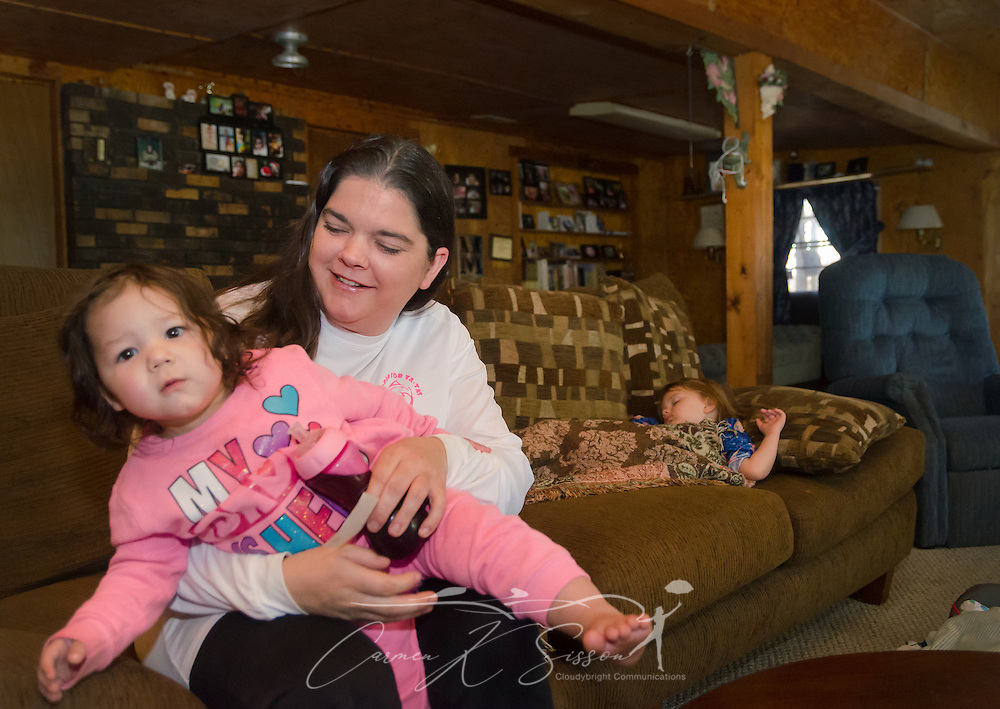 Former day care worker Sara Morales holds her daughter, 18-month-old Carleigh Morales, March 4, 2016, at her home in Loxley, Alabama. Morales worked briefly for day care owner Deborah Stokes at A Step Ahead Christian Day Care but says she quit because Stokes yelled at the children and failed to pay her. Morales now babysits children in her home. Stokes recently opened a new day care, Little Nemo's, in Spanish Fort, Alabama. (Photo by Carmen K. Sisson/Cloudybright)