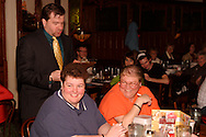 """Jerry Francis (standing) during Mayhem & Mystery's production of """"Fashion Friction"""" at the Spaghetti Warehouse in downtown Dayton, Monday, March 21, 2011."""