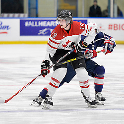 WHITBY, - Dec 18, 2015 -  Game #12 - Bronze Medal Game, Team Canada East vs. United States at the 2015 World Junior A Challenge at the Iroquois Park Recreation Complex, ON.  Brett Murray #17 of Team Canada East tries to get past Collin Peters #17 of Team United States during the second period.<br /> (Photo: Shawn Muir / OJHL Images)