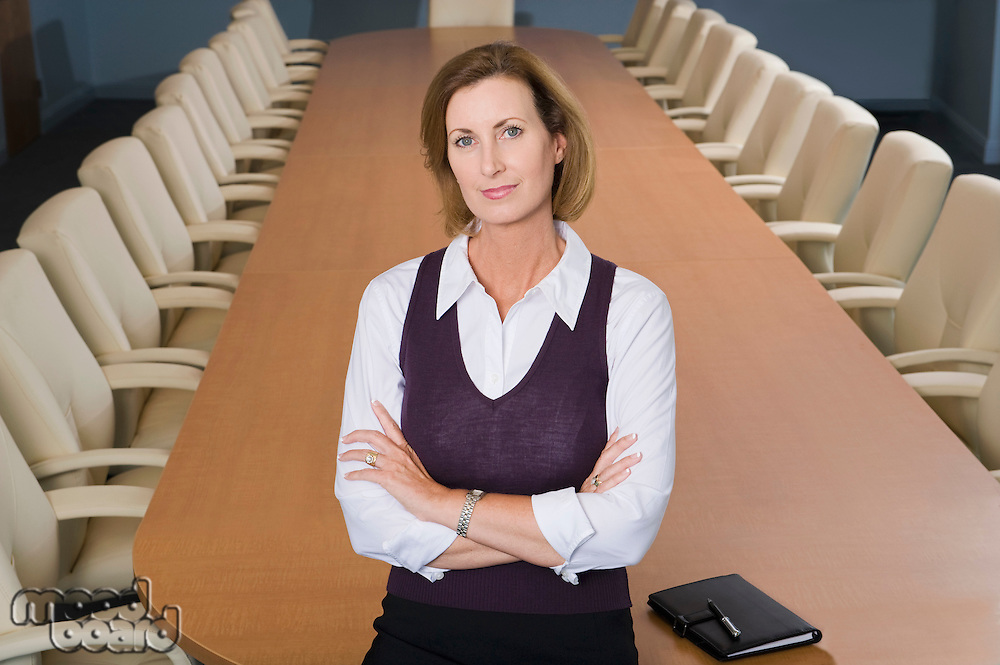 Businesswoman Standing in Meeting Room High Angle