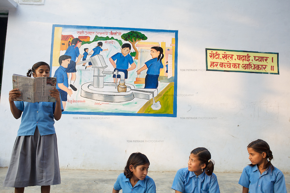 A meeting of the children's cabinet at Kachnar primary school beside a painted poster depicting students using a handpump. The cabinet, introduced by UNICEF, aims to encourage child involvement in the maintenance and the cleaning of the school's water and sanitation facilities. The cabinet promote personal hygiene and encourage child to child and child to parent interaction on hygiene. ..UNICEF and the Uttar Pradesh Government, have identified 100 model Gram Panchayats (local-level village administration) in Varanasi District (out of a total of 702). The promotion of good sanitation and hygiene practices in these Gram Panchayats allows them to serve as examples for the remaining areas of the district to emulate. The promotion of hygiene and sanitation includes the construction and painting of school toilet blocks, the construction of individual toilets in households, the digging of garbage pits, recycling waste water and encouraging personal hygiene awareness. ..Only 32 percent of those living in Uttar Pradesh, India's largest state, have access to a toilet. Uttar Pradesh faces many challenges in it's efforts to address this deficiency. UNICEF supports the Uttar Pradesh government's sanitation and hygiene project at both the state and district levels. UNICEF is working to increase the capacity of all of those involved in the sanitation and hygiene project from state-level administrators through to Panchayati Raj (local-level administration) officers and influential individuals, including teachers, who live among rural communities. UNICEF has prioritised the need to communicate the importance of good sanitation and hygiene practice to these communities. The Uttar Pradesh government and UNICEF have focussed their campaign on eight districts (including Varanasi) with the intention that these serve as models for the remaining 62 districts of the state. UNICEF have identified areas of shortcoming within the government program and proposed solutions. These solutions inclu