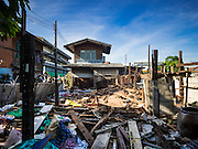 12 NOVEMBER 2015 - BANGKOK, THAILAND: A now empty lot that used to be a home near Wat Kalayanmit. Fifty-four homes around Wat Kalayanamit, a historic Buddhist temple on the Chao Phraya River in the Thonburi section of Bangkok, are being razed and the residents evicted to make way for new development at the temple. The abbot of the temple said he was evicting the residents, who have lived on the temple grounds for generations, because their homes are unsafe and because he wants to improve the temple grounds. The evictions are a part of a Bangkok trend, especially along the Chao Phraya River and BTS light rail lines. Low income people are being evicted from their long time homes to make way for urban renewal.       PHOTO BY JACK KURTZ