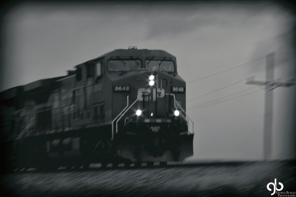 I was on the interstate west of BIg Timber taking a picture of a rock formation when this train came by.