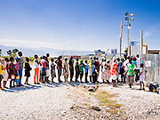 19 NOVEMBER 2010 - PORT-AU-PRINCE, HAITI:  People line up to visit family members at a Medicins Sans Frontieres (MSF - Doctors Without Borders) cholera treatment center near the airport in Port-au-Prince. Cite Soleil, a sprawling slum area in PAP is ground zero for the cholera epidemic in the Haitian capital. An outbreak of cholera in northern Haiti about a month ago has spread across the nation. Tens of thousands of people have been hospitalized and treated for cholera and more than 1,100 have died. Cholera is a water borne illness that causes severe diarrhea and death by dehydration in a matter of hours.      PHOTO BY JACK KURTZ    choleraepidemic