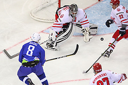 Luka Basic of Slovenia vs Przemyslaw Odrobny of Poland and Damian Tomasik of Poland during Ice Hockey match between National Teams of Slovenia and Poland in Round #2 of 2018 IIHF Ice Hockey World Championship Division I Group A, on April 23, 2018 in Budapest, Hungary. Photo by David Balogh / Sportida