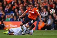 Andy Drury of Luton Town is tackled by Tom Soares of Bury during the Sky Bet League 2 match at Kenilworth Road, Luton<br /> Picture by David Horn/Focus Images Ltd +44 7545 970036<br /> 19/08/2014