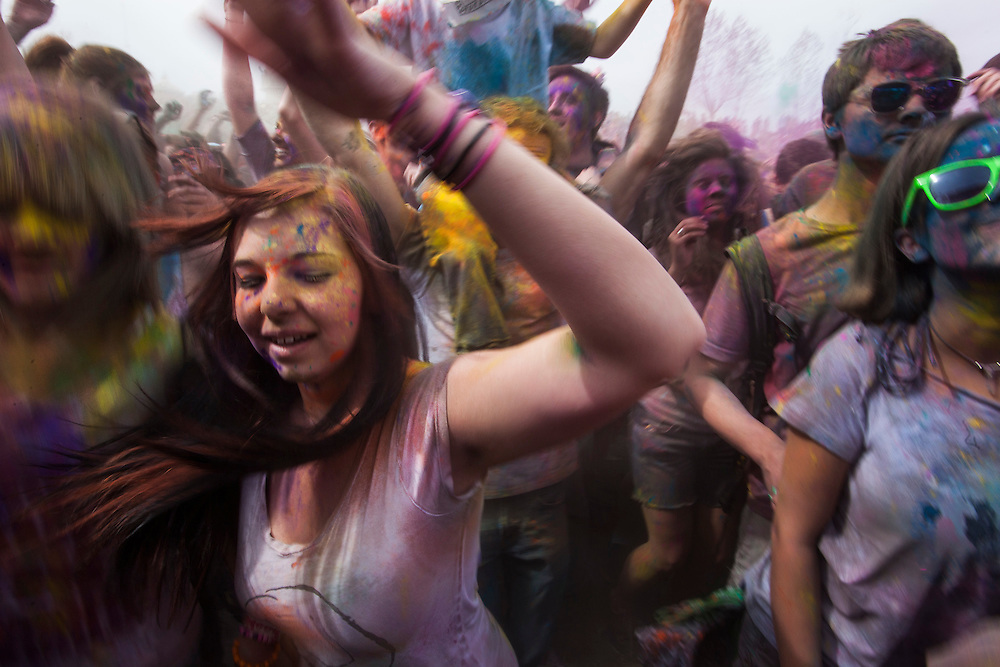 Crowds jump up and down to music in front of the stage during the Holi Festival of Colors, on Saturday, Mar. 24, 2012, at the Lotus Temple, in Spanish Fork, Utah. (Photo by Benjamin B. Morris ©2012)