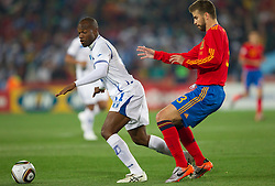 David Suazo of Honduras vs Gerard Pique of Spain during the 2010 FIFA World Cup South Africa Group H Second Round match between Spain and Honduras on June 21, 2010 at Ellis Park Stadium, Johannesburg, South Africa.  Spain defeated Honduras 2-0. (Photo by Vid Ponikvar / Sportida)