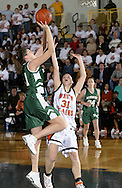 Minisink Valley's Stefanie Dolson, left, takes a shot over Liz Flooks of White Plains during a Class AA state tournament game at Pace University in Pleasantville on March 10, 2006.