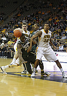 February 2 2011: Iowa Hawkeyes guard/forward Eric May (25) tries to drive with the ball as Michigan State Spartans forward Draymond Green (23) defends and Iowa Hawkeyes forward Jarryd Cole (50) looks on during the first half of an NCAA college basketball game at Carver-Hawkeye Arena in Iowa City, Iowa on February 2, 2011. Iowa defeated Michigan State 72-52.
